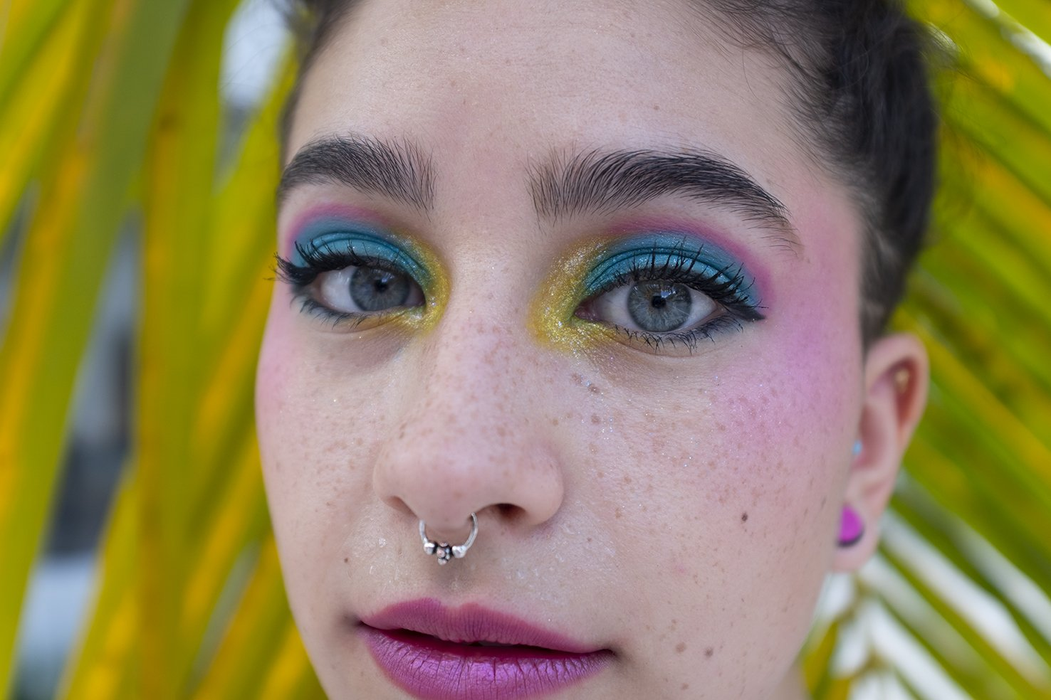 """The artist presents her intimate and cultural research through the shot """"Midtown"""", a macro image of made up eyes, which ponders on both daily life and interactions with """"the other and diversity"""". She investigates the dynamics that are created through the lens of the camera."""